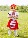 Child in russian folk clothes on grass Stock Photos
