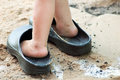Child's feet in big sandals Royalty Free Stock Photo
