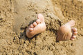 Child s feet in the sand close up Royalty Free Stock Photo