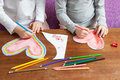 Child`s Hands are Drawing Colorful Hearts