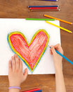 Child`s Hands are Drawing a Heart That.