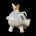Child s piggy bank with two dollar bill handmade art class on black background Stock Photography