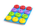 A child s screws and bolts colorful plastic attached in blue cardboard toys for children Stock Photos