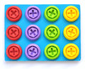 A child s screws and bolts top colorful plastic attached in blue cardboard toys for children Royalty Free Stock Images
