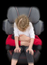 Child safety seat concept on black background Royalty Free Stock Images
