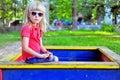 Child in the sandbox sitting Stock Photos