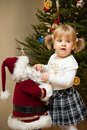 Child and Santa Claus Doll Stock Images