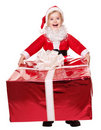 Child in santa costume giving gift box. Stock Photo