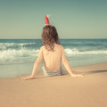 Child in santa hat at the beach rear view of sitting tropical christmas holidays concept Royalty Free Stock Images