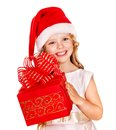 Child in Santa hat with gift box. Royalty Free Stock Photography