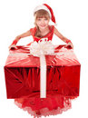 Child in santa hat giving red gift box. Stock Image