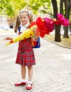 Child with school cone holding gift outdoor Royalty Free Stock Image
