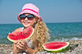 Child on the sea with watermelon Royalty Free Stock Image