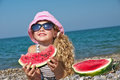 Child on the sea with watermelon Royalty Free Stock Photo