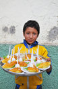 Child selling food on the streets of Northern Peru Royalty Free Stock Images
