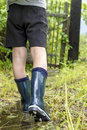 Child In Shining Gumboots Goes...