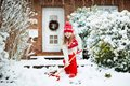 Child shoveling winter snow. Kids clear driveway. Royalty Free Stock Photo
