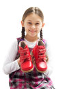 Child shows shoes on a white background Royalty Free Stock Image