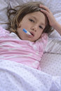 Child sick at home using thermometer Royalty Free Stock Photo