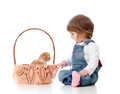Child sitting down by basket with kittens, Royalty Free Stock Photos
