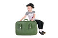 Child sitting in an old green suitcase Royalty Free Stock Photo