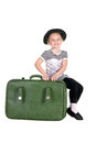Child sitting on old green suitcase Royalty Free Stock Images