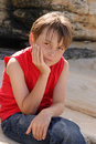 Child sitting on rocks Royalty Free Stock Photo