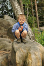 Child sitting on stone Royalty Free Stock Photo