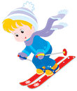Child skiing little boy or girl down a mountain slope Royalty Free Stock Photos