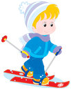 Child skiing little boy or girl walking on skis Royalty Free Stock Image