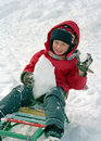 Child sledge on snow Stock Images