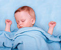 The child sleeping in bed Stock Photos
