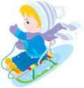 Child sleighing little boy or girl sitting in a sled and sliding down Royalty Free Stock Photo