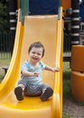 Child on a slide Royalty Free Stock Images
