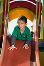 Child on slide Stock Image