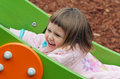 Child on slide Royalty Free Stock Image