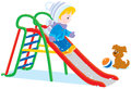 Child on a slide little boy or girl sliding down Royalty Free Stock Image