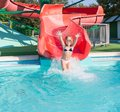Child on a slide in the water Park. Royalty Free Stock Photo