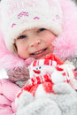Child with snowman in winter Stock Photos