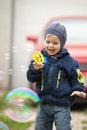 Child and soap balloons making outdoor Stock Photography