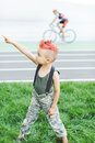 Child on something shows. Kid having fun outdoors..A little boy with red hair. Child in uniform. The child indulges, croaks.The bo Royalty Free Stock Photo