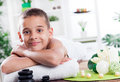 Child spa treatment boy ready for massage in the salon Royalty Free Stock Image