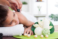 Child spa treatment young boy relaxing in stone massage Stock Image