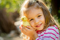 Child with spring duckling little girl close up Royalty Free Stock Photos