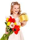 Child with spring flower and gift box. Royalty Free Stock Images