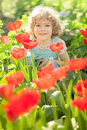Child in spring garden Stock Photography