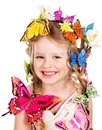Child in spring hairstyle and butterfly. Royalty Free Stock Photos