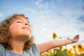 Child in spring happy outdoors sunflower field Stock Photography
