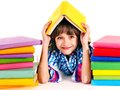 Child with stack of books isolated Royalty Free Stock Images