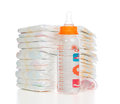 Child stack of diapers, nipple soother, baby feeding milk bottle Royalty Free Stock Photo